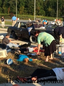 Victims after car crashes into yard sale.